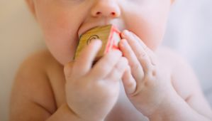 How to survive teething with a reflux baby
