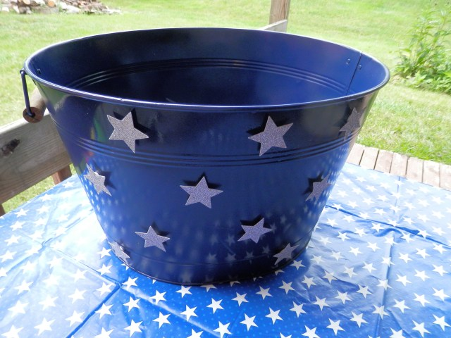Old Beverage Tub spray painted and stars added!  Awesome results!