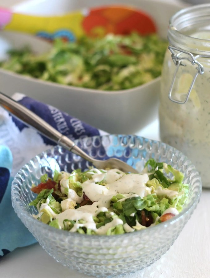 Brussels sprouts, avocado and bacon salad with creamy dill dressing