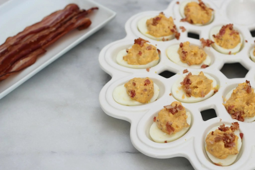 This is not your basic deviled egg recipe! These spicy bacon deviled eggs are so delicious and perfectly low carb!