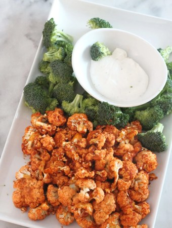 Air Fried Buffalo Cauliflower bites. Perfectly cooked, low carb and tasty. It's a healthy choice for game day or any day! #lowcarbdelish #airfryerrecipes #lowcarbsnacks #lowcarbappetizers #ketosnacks #ketorecipes