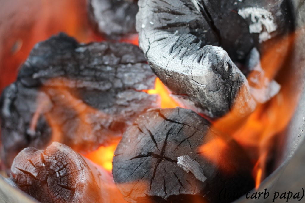 Burning lump charcoal in a starter to be used for making Smoke Roasted Ribeye