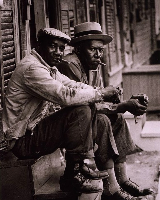 Two-African-American-men-sitting-on-stoop-Charleston-SC