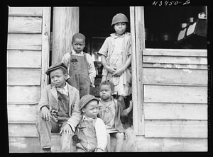 Family of small landowner who moved out of the Santee-Cooper Basin, at their new home near Bonneau, South Carolina LOC 8c04881v