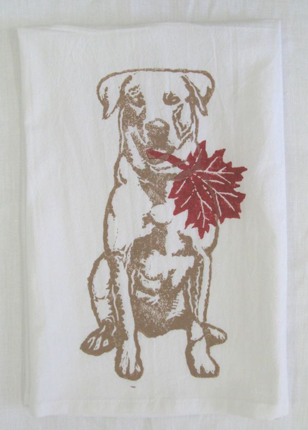 Retriever with maple leaf towel