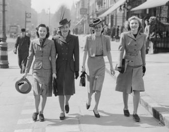 Four women photographed on a London street wearing 1940s wartime clothing