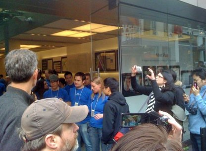 long line of customers in front of the flagship Apple Store on Stockton Street in San Francisco