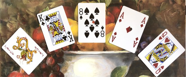 poker hand: Joker, King of Clubs, 8 of Spades, Ace of Diamonds, Queen of Hearts