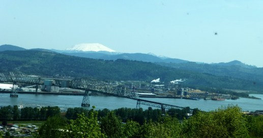 Crossing the state border in Washington. Note Mt St Helens peeking thru the mountains