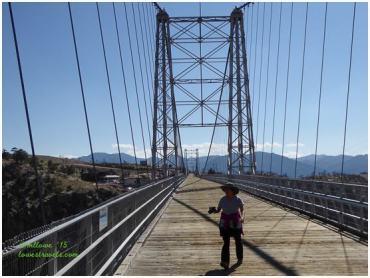 A little person on a big bridge