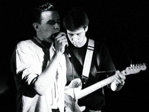 Black and white photo of The Gits in Concert at Champagnes Horsham with Jim and Matt singing and playing guitar