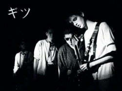 1988 photograph of The Gits with Rob guitaring and the rest looking on