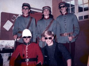 The Mark 1 line up of Business On Bicycles dressed in 19th century military uniforms before a gig in 1985