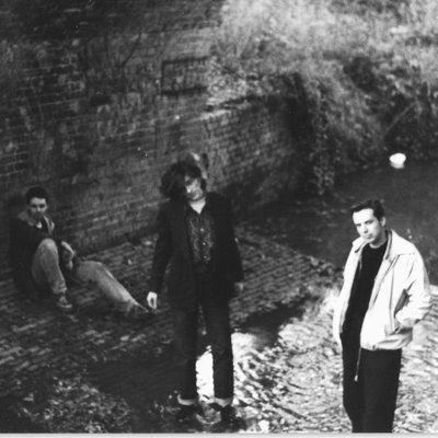 Rob, Ben & Jim of the Gits stood under a small arched bridge in Horsham