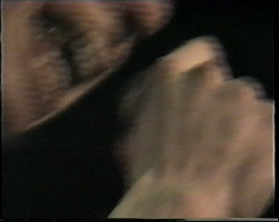 The lower face and teeth of Jim seen in blurred close up