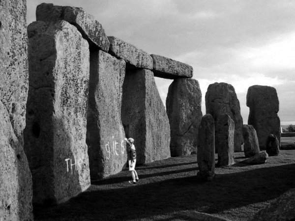 Ben writing 'The Gits' on Stonehenge