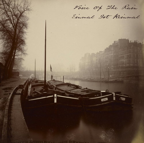 The front cover of Einmal Ist Keinmal which is a photograph by Eugène Atget taken in 1923, Boats Near the Pont Neuf, of long, low, river barges