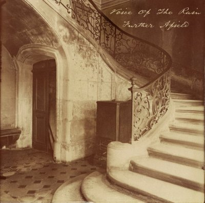 The front cover of Further Afield which is a phtograph, Hotel de la Brinvilliers, l'empoisonneuse, Rue Charles V, taken by Eugène Atget in 1900. It shows the interior of an abandoned building with a large stone staircase which twists back on itself as it climbs.