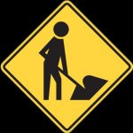 Road side information style sign in black on yellow showing a man digging