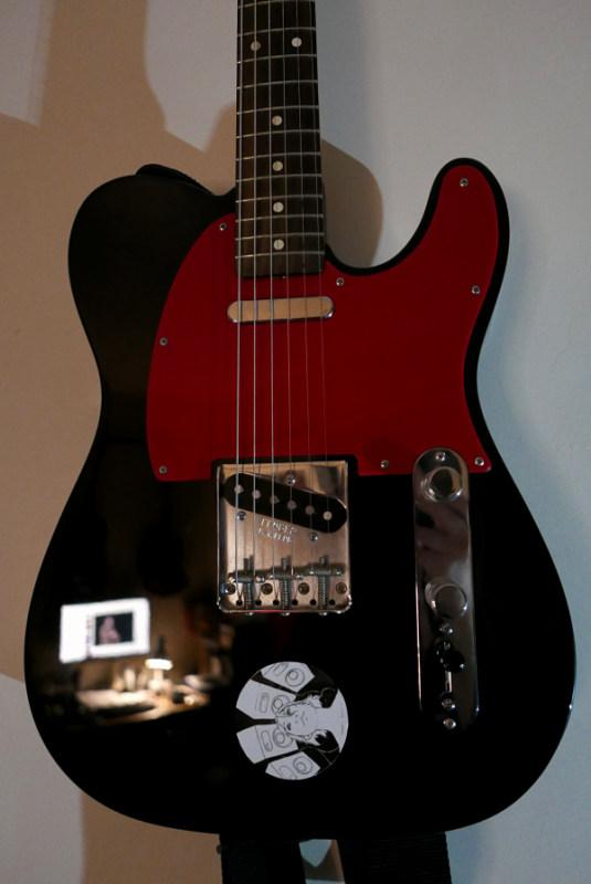 A Fender Telecaster guitar with reversed controls to put the volume potentiometer nearer the right hand making it easier to reach when playing