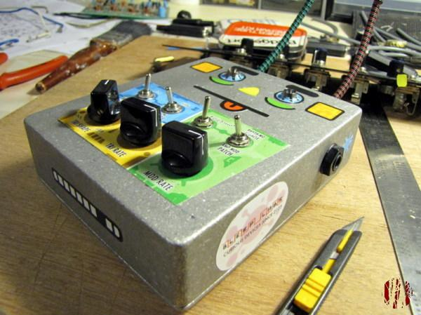 A build it yourself small synthesiser that looks a bit like a face operated by shinning torches on bendy supports at light sensitive diodes