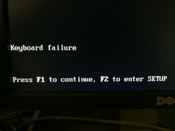 A computer screen showing Keyboard Failure followed by Press F1 to continue, F2 to enter Setup.