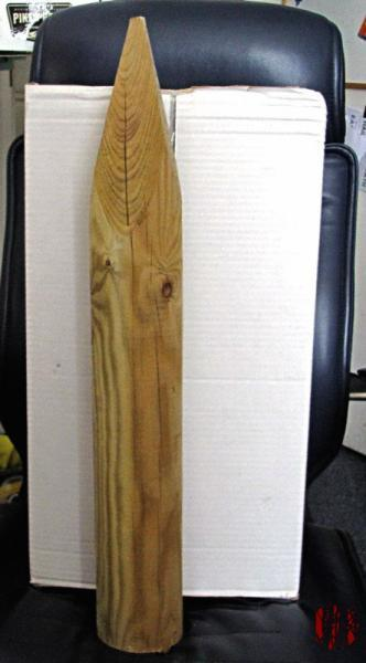 A big wooden stake. Over half a metre long and 15cm wide