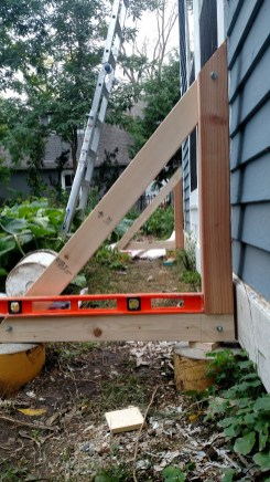 The triangular support for the solar panel installed level on the footings.