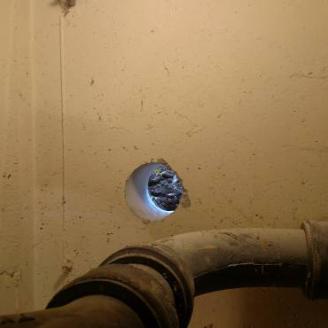 5-in hole through 8-in concrete foundation.