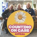 Claire Fulton, her carer Rachael Petrillo and Wigan and Leigh Hospice Community Fundraiser, Christine Edwardson.
