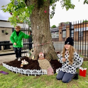 Golborne in Bloom volunteers in the Fairy Garden they have created at Golborne Library