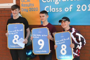 Lowton High pupils Kalum Brierley, Adam Dugdale and Ben McMillan celebrate their scores at GCSE.