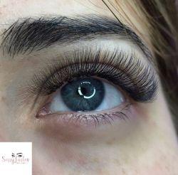 Closeup of female eye with full eyelashes