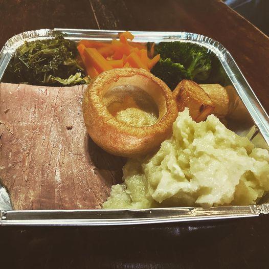 Takeaway roast dinner in a foil tray