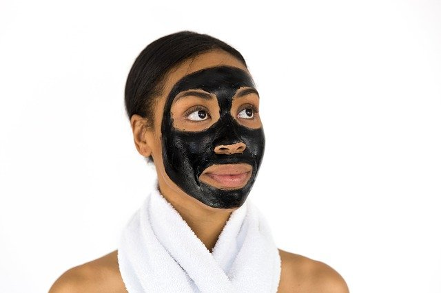 Woman wears face pack to improve her skin