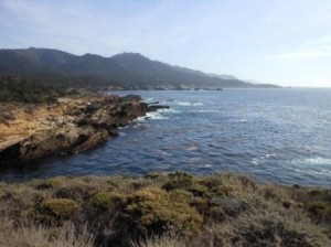 View from Point Lobos south along Big Sur Coast. Hyatt Carmel Highlands is visible near center.