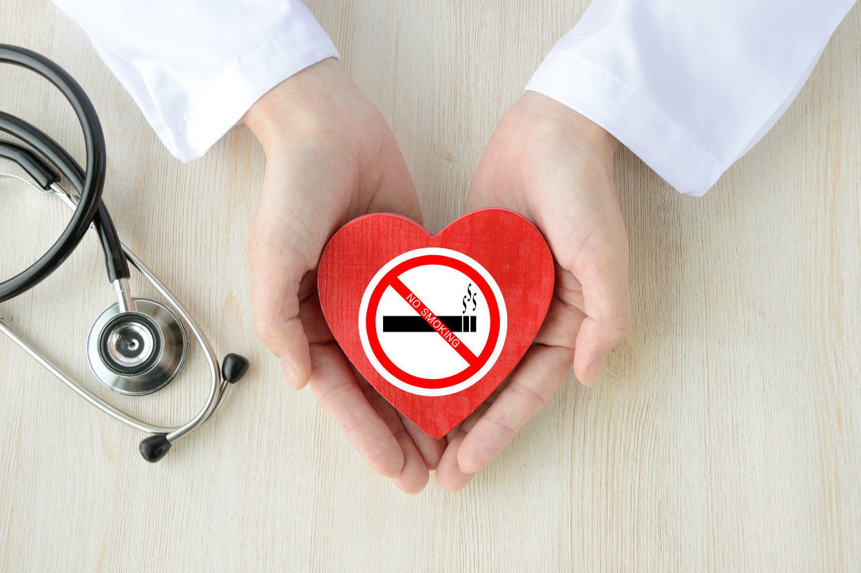 Doctor having heart object with no smoking sticker