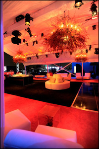 photo of interior entertainment area at night with red lighting, sofas cocktail areas for Interior of An Evening with Chrysler Group LLC