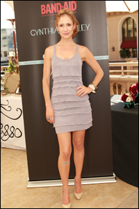 Photo of Ashley Jones posing wearing Band-Aid at Cynthia Rowley Designer Band-Aid Event