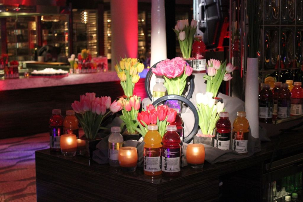 photo of flower arrangements with display of vitamin water