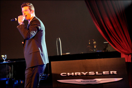 Photo of entertainer with microphone at An Evening with Chrysler Group LLC
