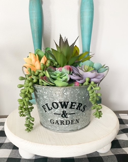 Finished Dollar Tree galvanized pail with faux suculents
