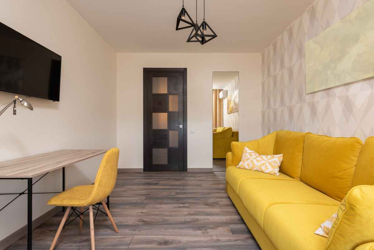 interior of modern apartment in yellow color