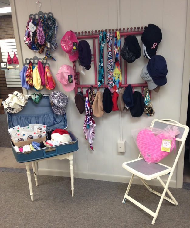 Hats and scarfs sold at the Pink Ribbon Boutique