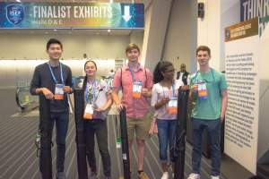 ISEF participants stand together at the fair