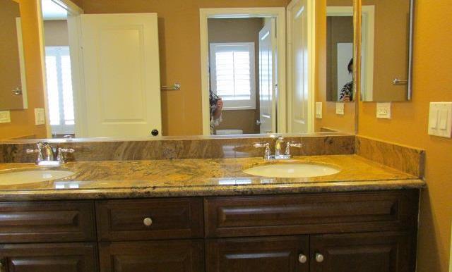 Dual Vanity Jack-and-Jill Bathroom for bedrooms 4 & 5.