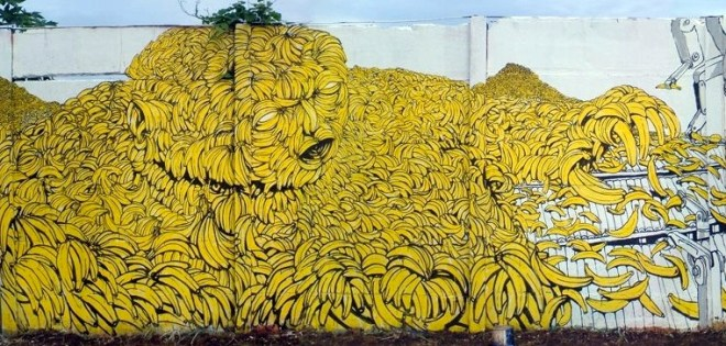 Street art mural by the artist Blu, depicting a gigantic man made of bananas