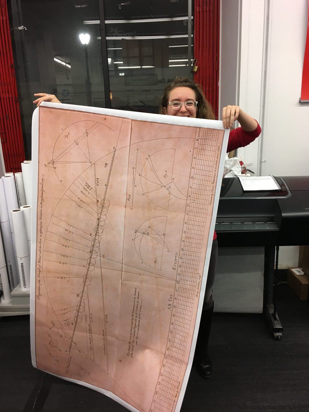 Laura Webb holding the final print of the enlarged Transit of Venus scan from 1769