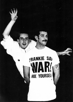 "Black and white picture of two men wearing white shirts. One shirt says ""Frankie Say War"" in all caps"