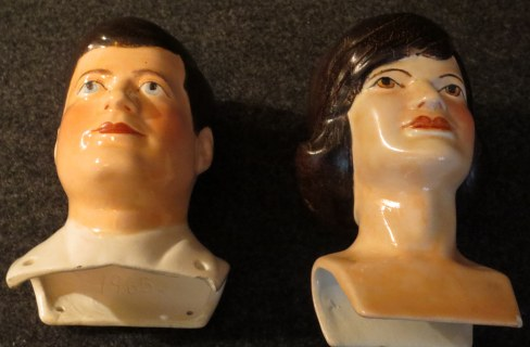 Creepy porcelain heads either for dolls or maybe puppets.